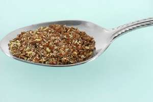 Spoon full of flax seeds.
