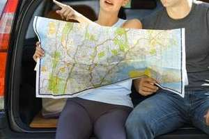 A couple reads a map.