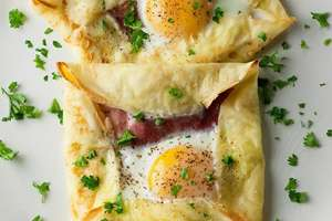 Egg and bacon inside pastry.