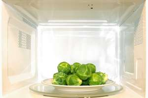 Brussels sprouts on a plate in the microwave.