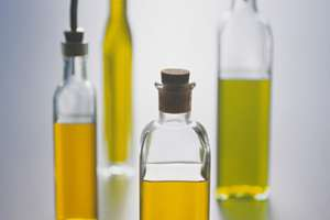 Four bottles of cooking oil.
