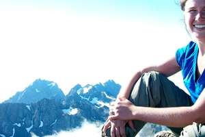 Student on mountain top