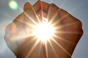 Hands cupped around the sun