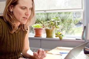 Laurie Mischley, ND, MPH, PhD(c) reviews test results.