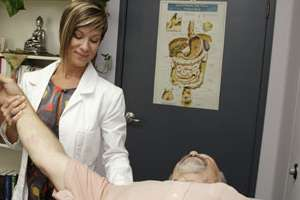 Dr. Mazza works with a patient