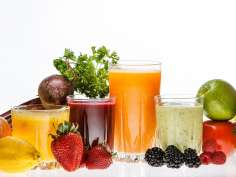 a row of healthy smoothies with fruits and vegetables