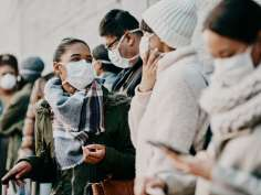 Group of people socializing with masks on