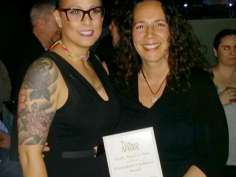 Bastyr faculty Ali Tromblay, LM, CPM, right, holds her Seattle Women's Pride award flanked by Jennifer Jimenez, CNM.