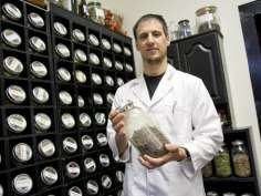 Sean Bradley holds jar of myrrh