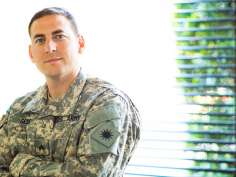 army veteran standing in clinic office