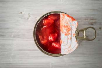 View above an open can of tomatoes