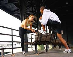 Picture of man and woman exercising