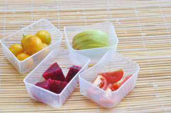 Plastic containers with fruit