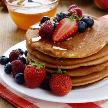 Coconut pancakes with fruit and honey