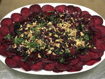 Beet Carpaccio with Dark Greens Salad on plate