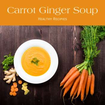 bowl of carrot soup with a bunch if carrots