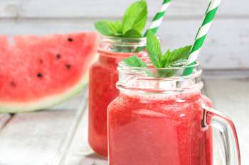 watermelon juice with a mint sprig leaf